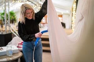 Bottom Drawer Bridal preparing wedding dress at Applewood Hall