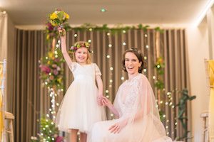 Bride and Flower Girl with Styled Ceremony Arch