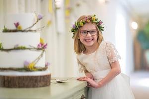 Flower girl and rustic wedding cake